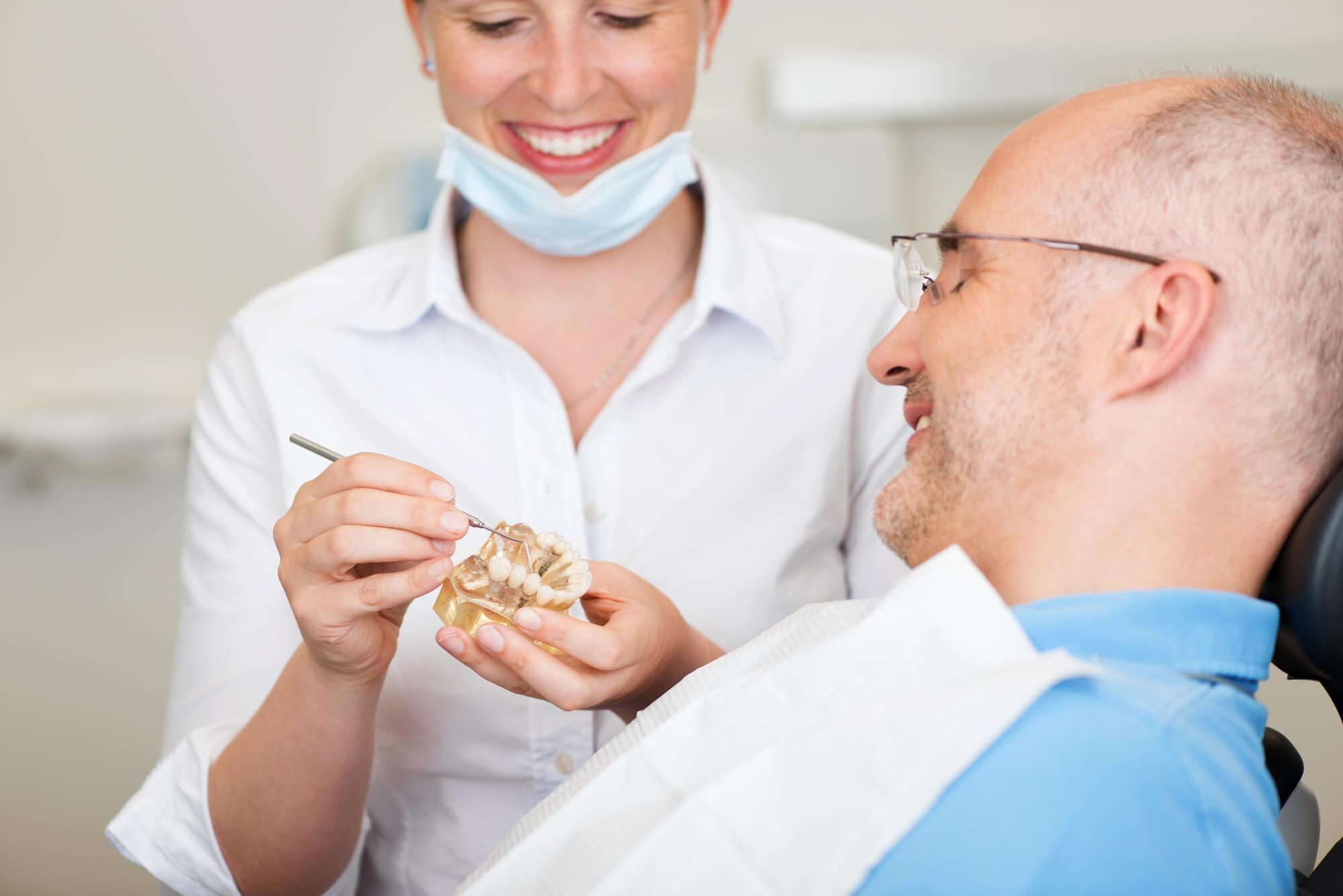 Dentist showing patient Same Day Dental Crowns Everett WA
