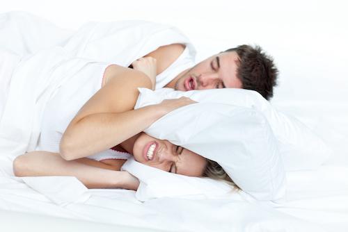 person snoring keeping partner awake