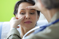 lady having face examined at sinus points