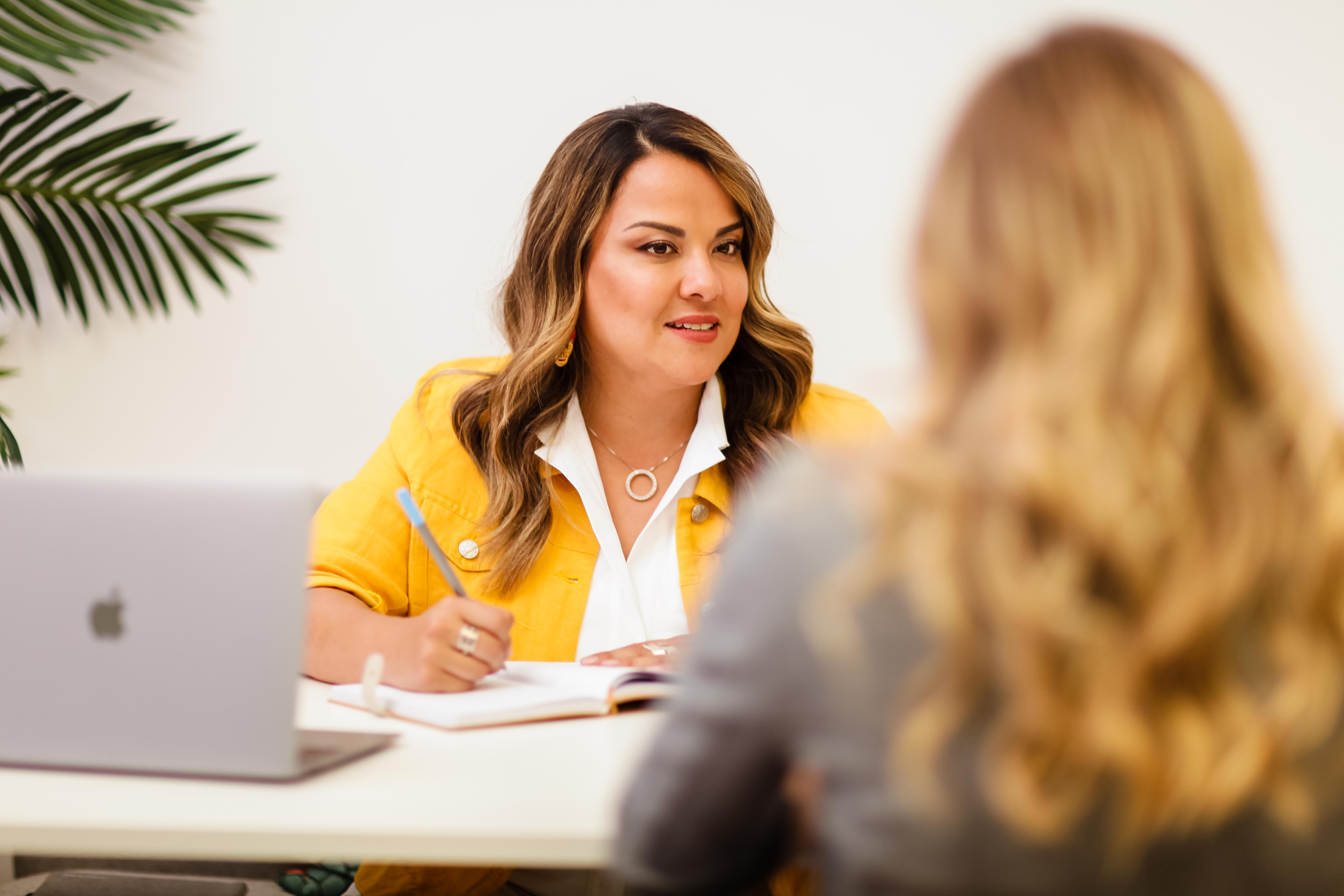 Karla Briones talking with a client