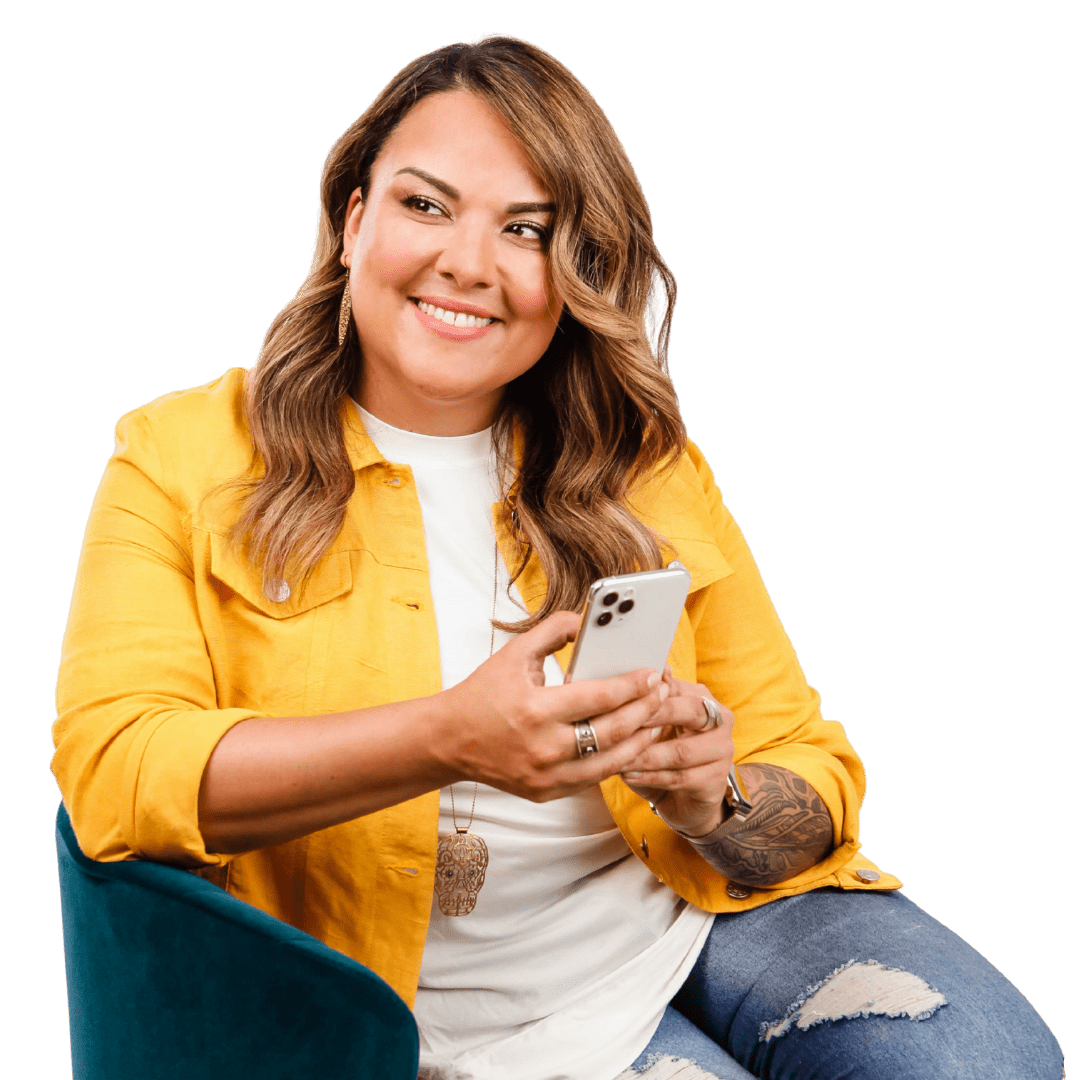 Karla Briones in a yellow jacket, holding a phone