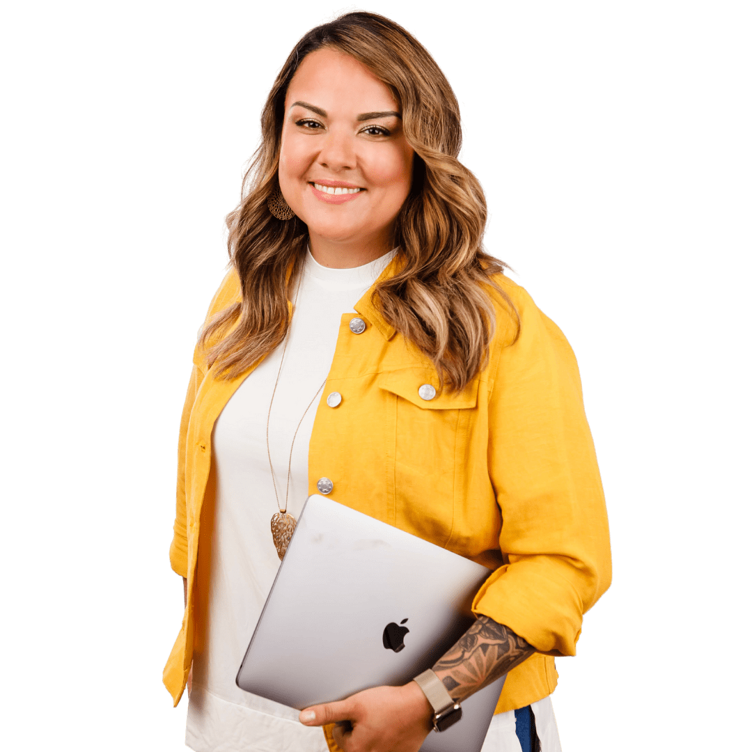 Karla Briones in a yellow jacket holding a laptop