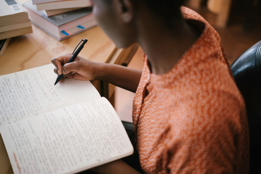 A woman studying the Bible and taking notes