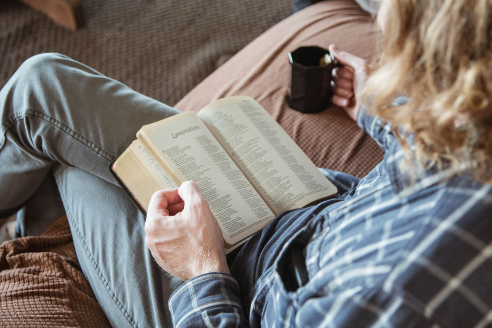 A man reading the Bible with a coffee