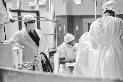 Black and white image of doctors wearing PPE gear.