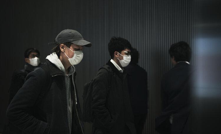 Man walking while wearing a mask