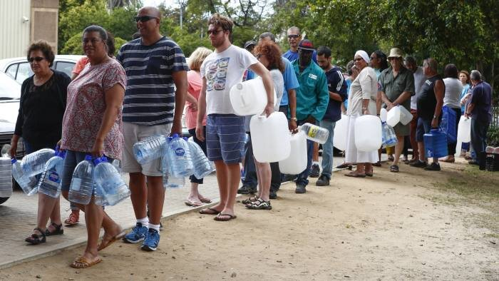 Citizens in Cape Town wait in line for fresh water.