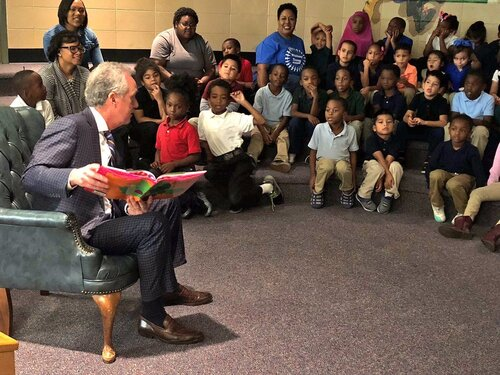 City leader reads book to a group of children.