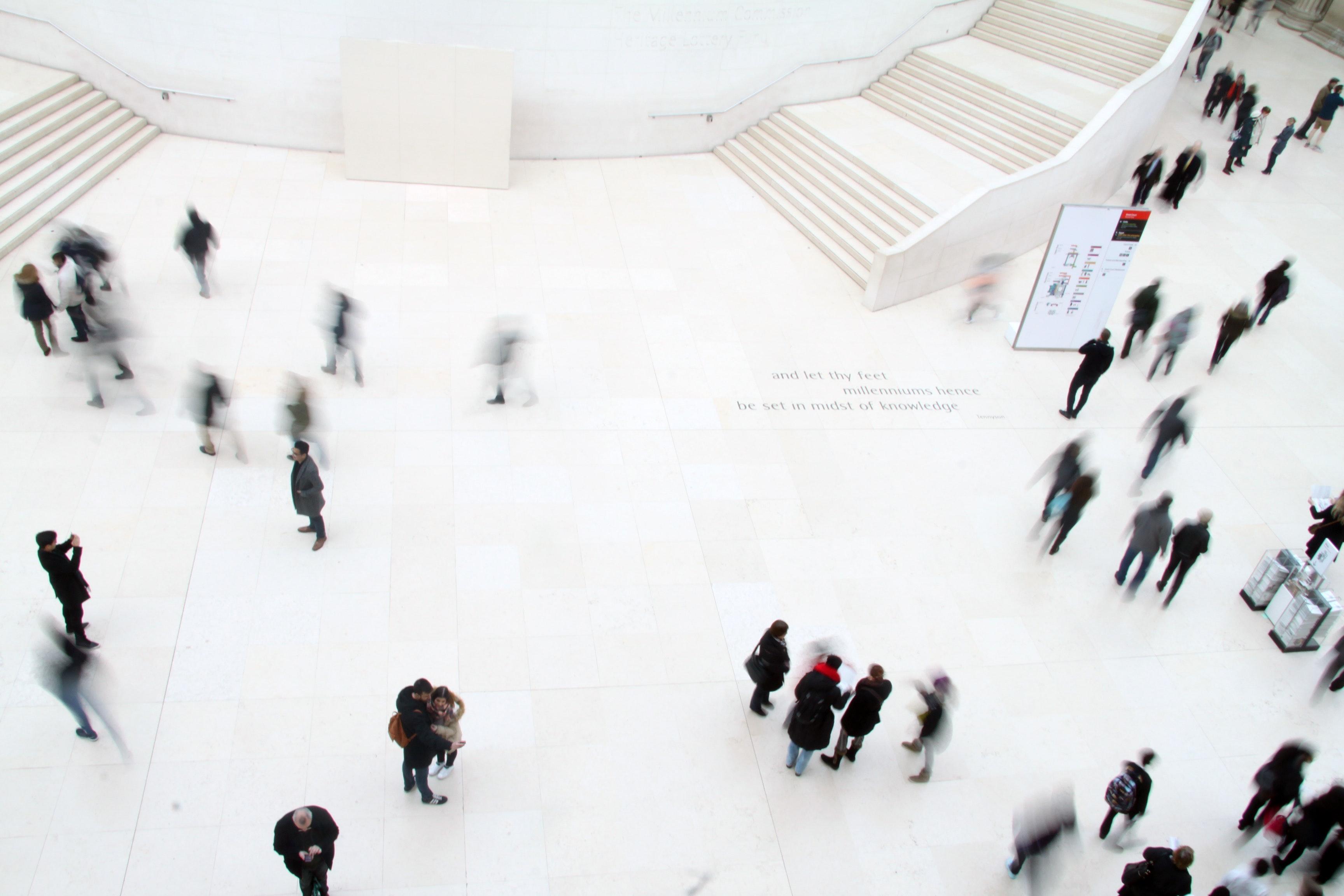 Aerial view of bystanders walking through a cross walk