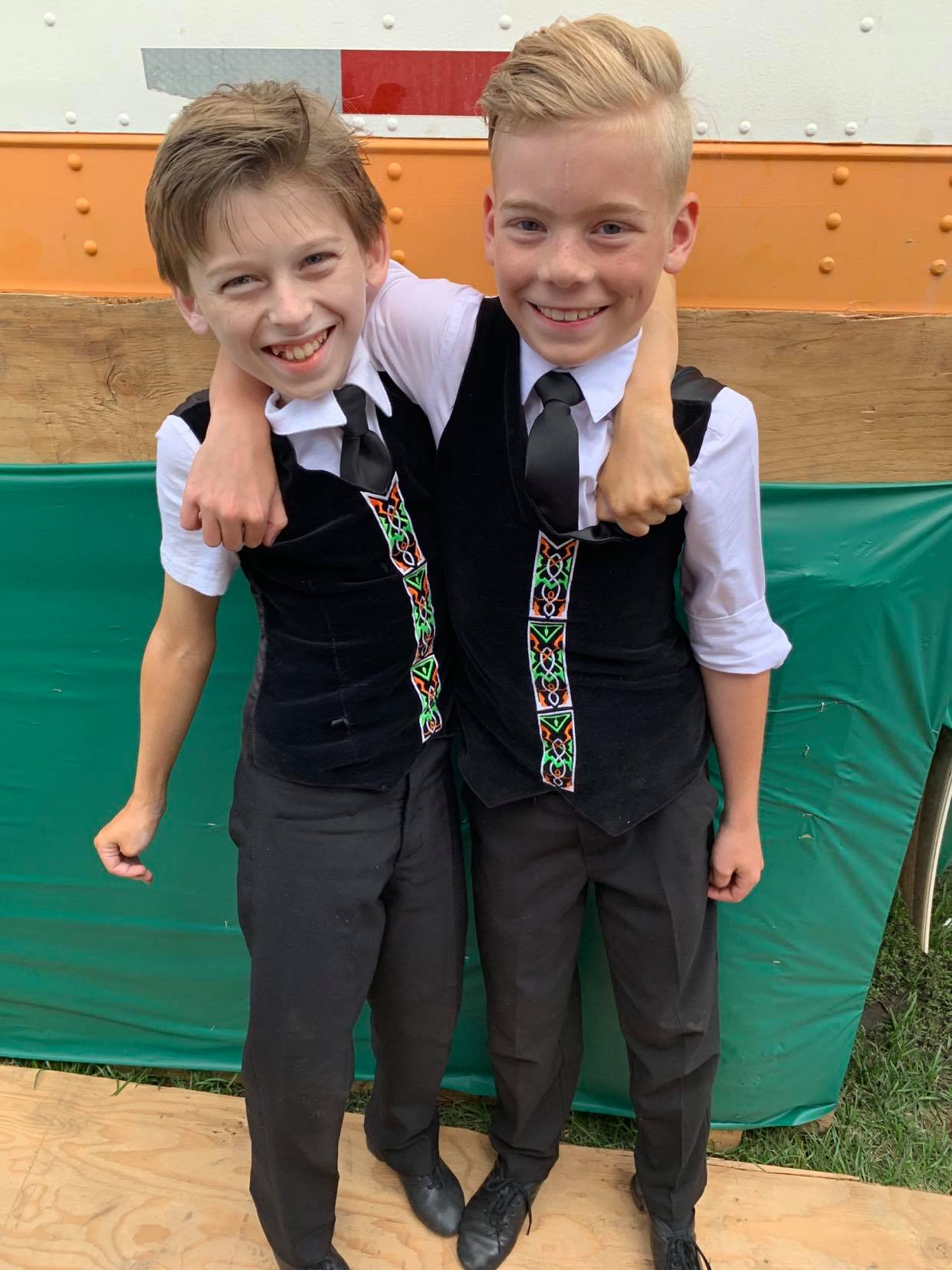 Two boys who dance at Mattierin smiling side stage at the Servus Heritage Days Festival in Edmonton, AB