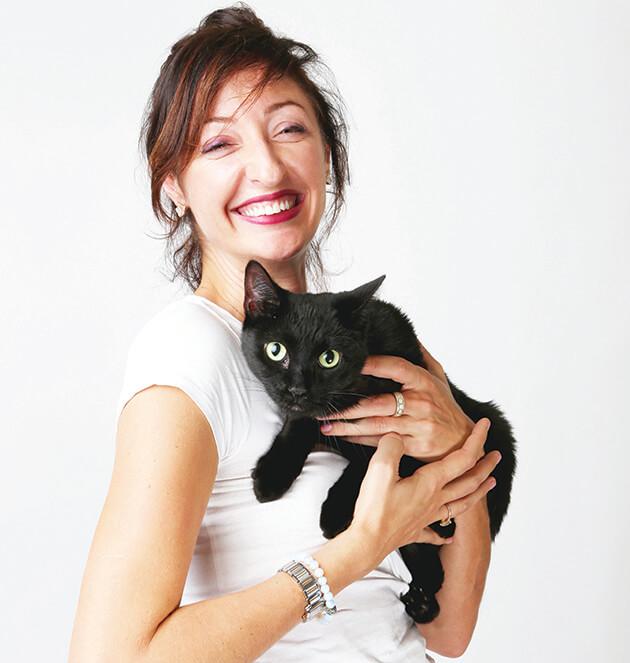 Anna hugging cat