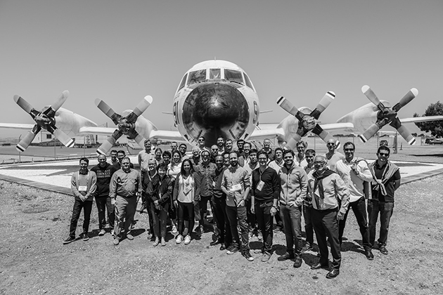 Faculty in front of an airplane