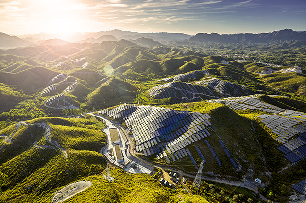 Solar panels cover south-facing hillsides in a part of rural China.