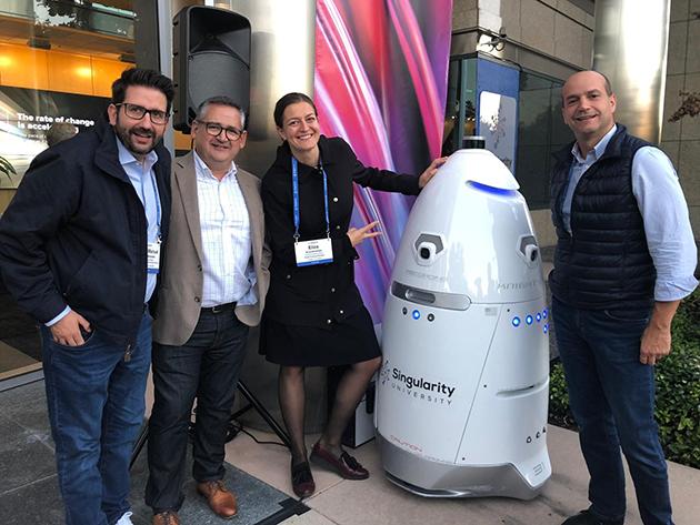 Singularity University Executive Program - Participants with a Robot