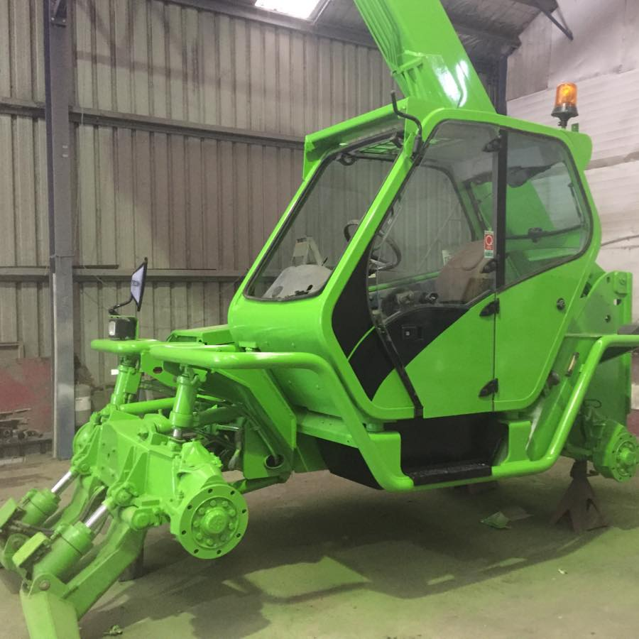 green machine being painted