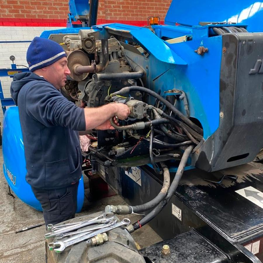 machine technician working on machine