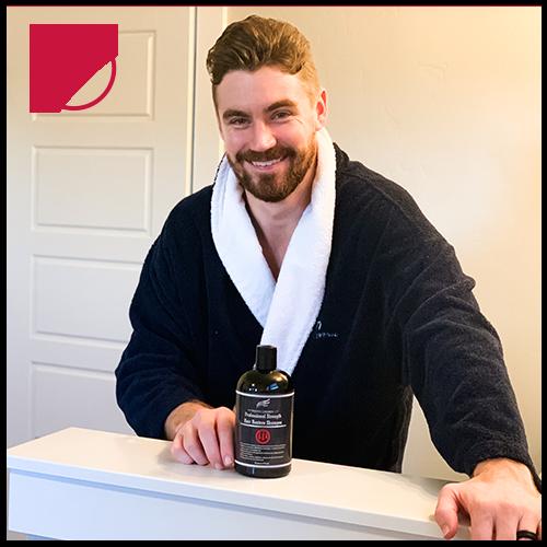 A man using Hair Restoration Labs Professional Strength Shampoo