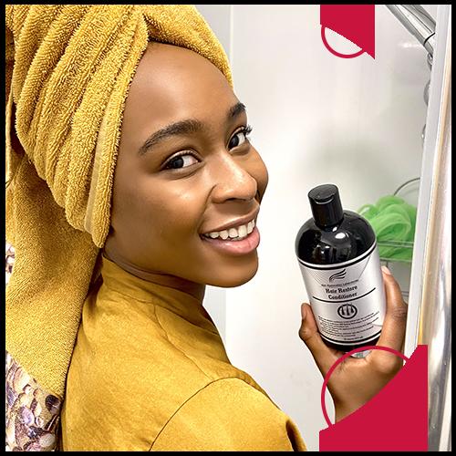 A woman using Hair Restoration Laboratories Hair Restore Conditioner