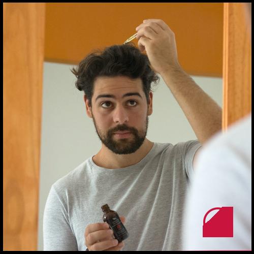 A man using Hair Restoration Laboratories Ultra Strength Hair Regrowth Treatment