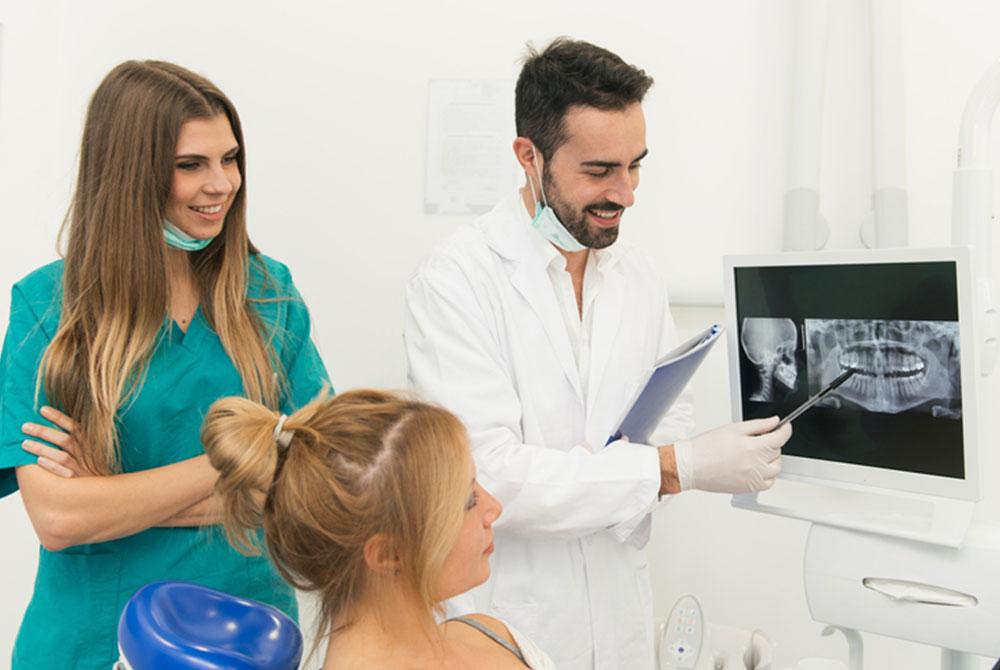Dentist checking digital X-rays