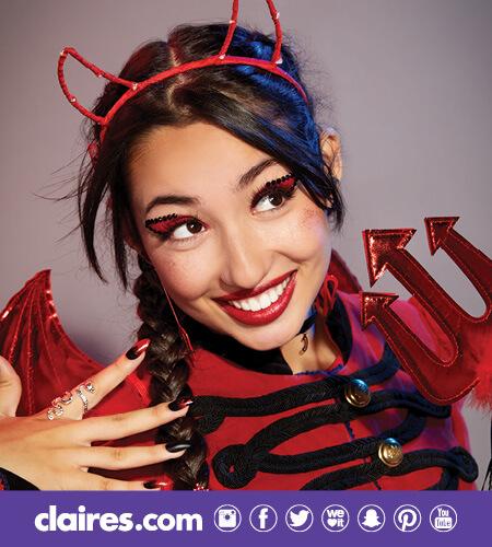 Teen girl wearing a Devil Costume