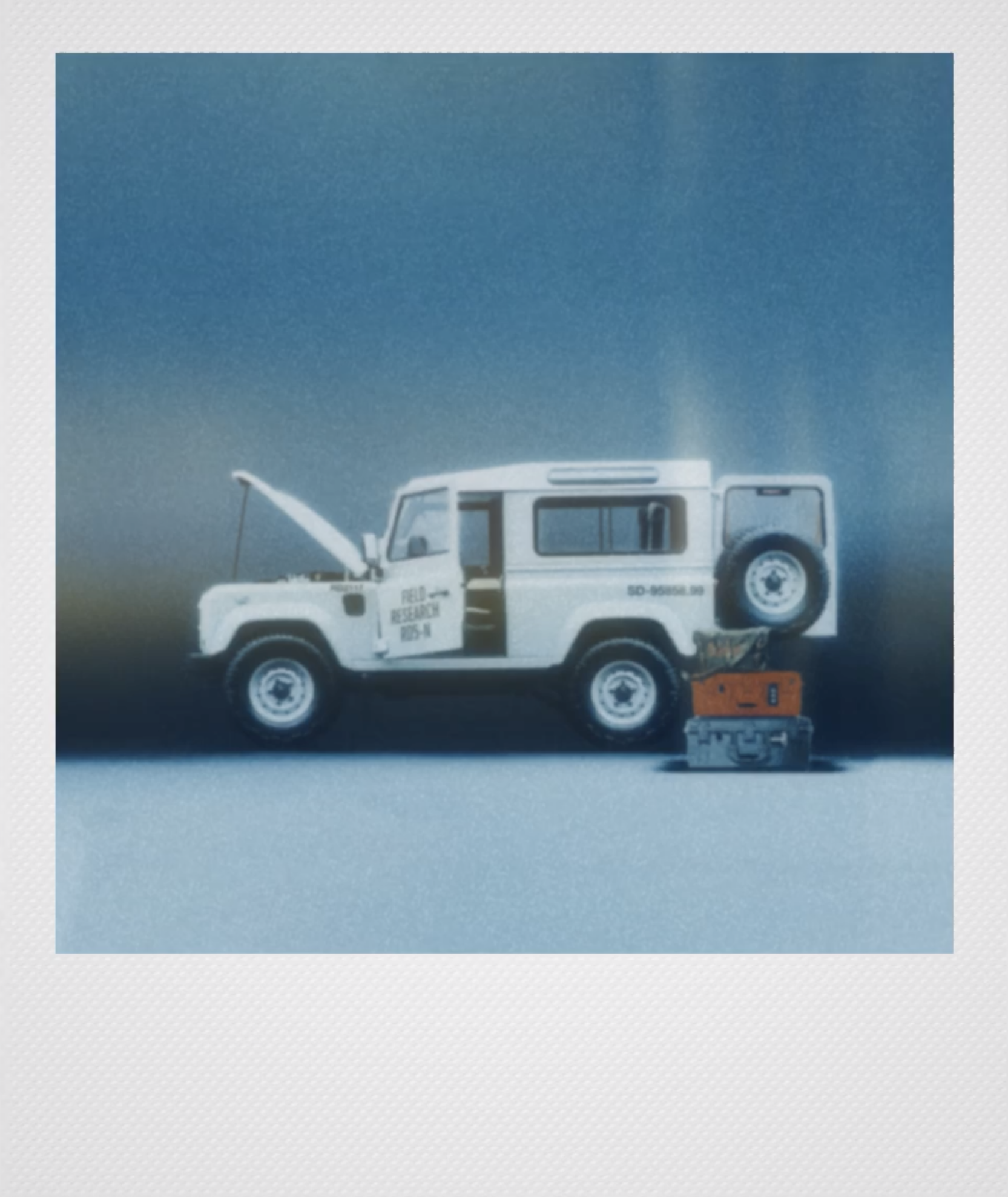 Photo of an SUV with Polaroid style effects designed by Casey Warren with RTRO Camera's Analog Effects Engine