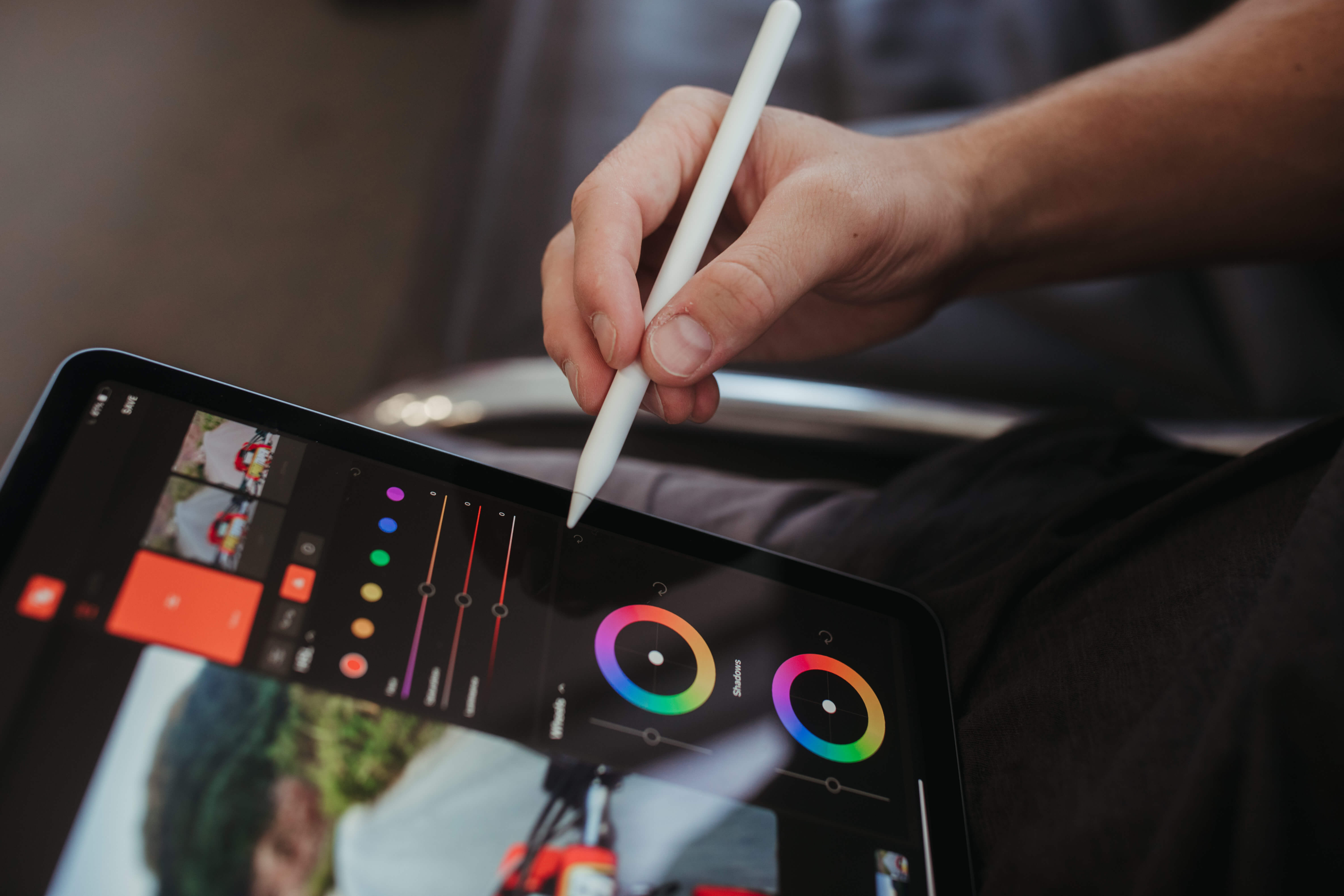 Hand uses apple pencil to adjust color wheels on the Grain iPad app.