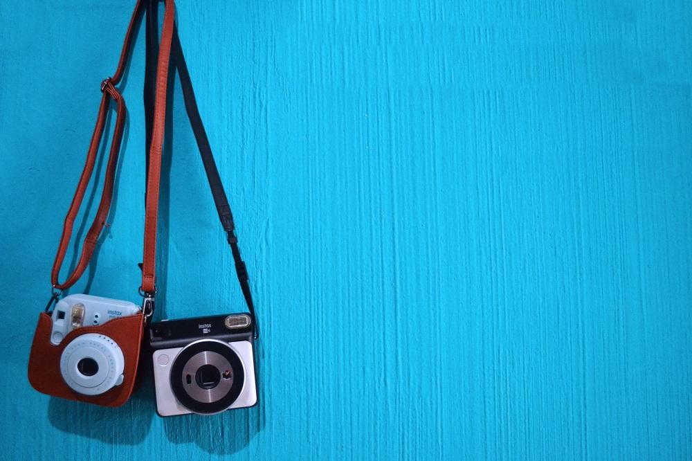 Two cameras hanging