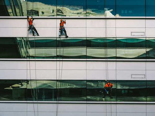 Men cleaning windows on high-rise