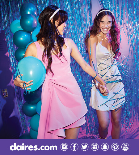 Two teen girls at a homecoming dance wearing Claire's accessories