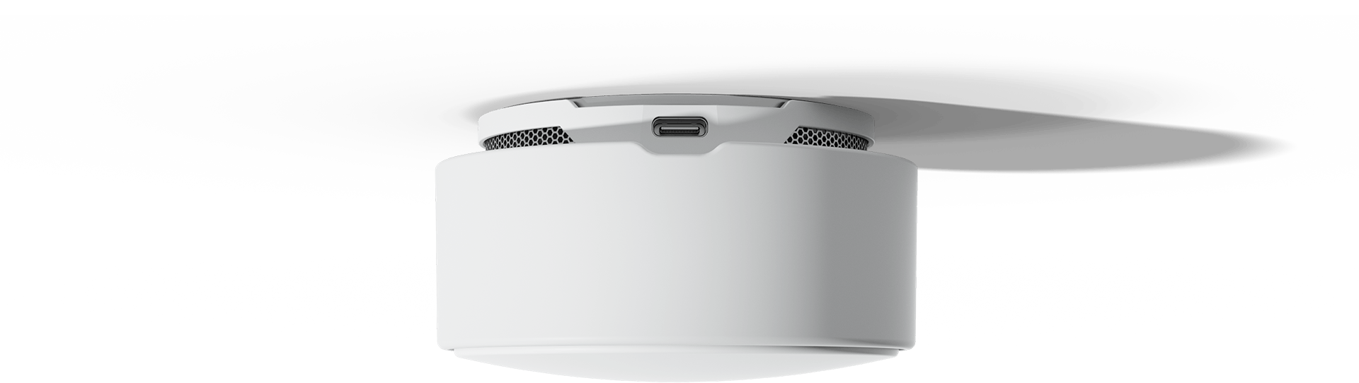 Minut Home Sensor with the usb-c port facing the viewer