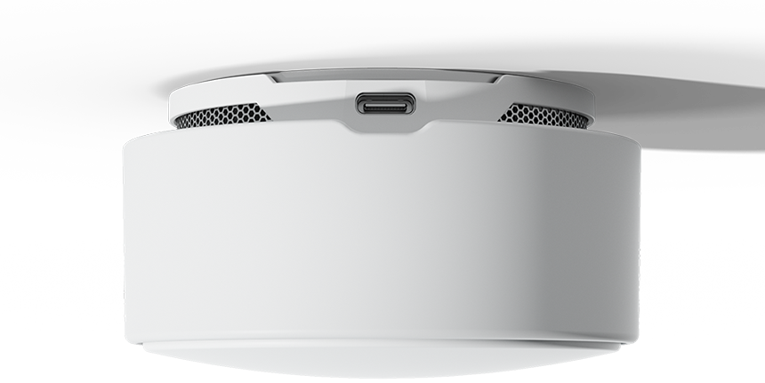 A Minut Home Sensor with the usb-c port facing the viewer