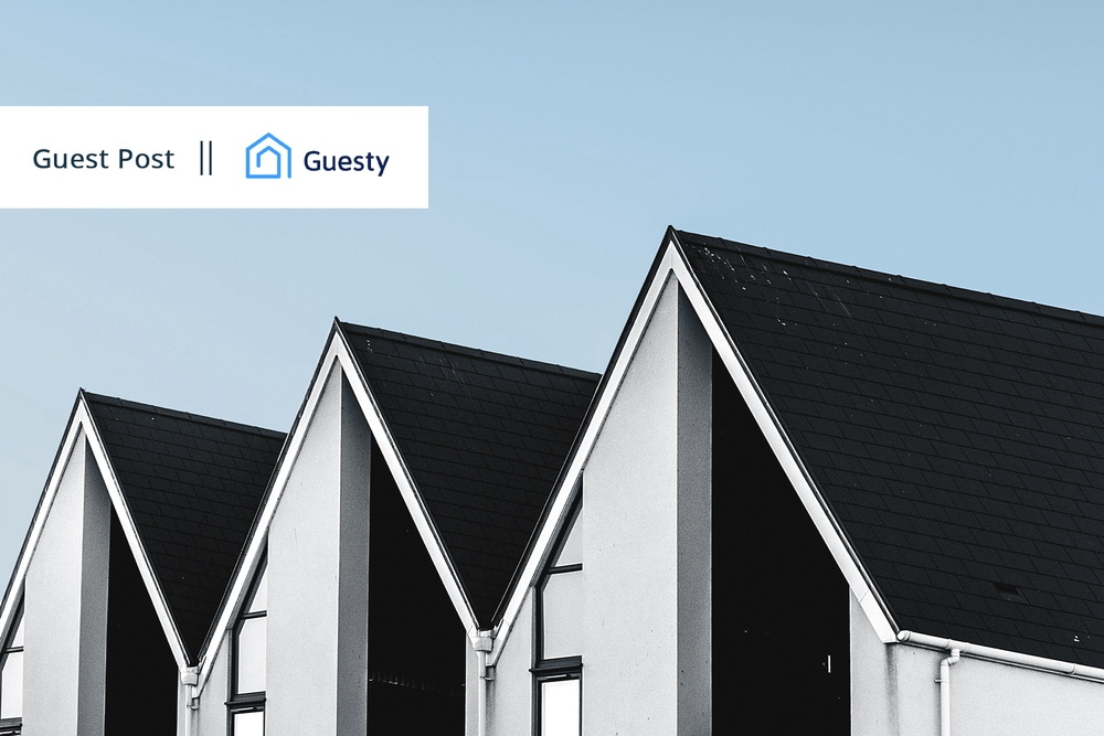 Three houses with Guesty logo