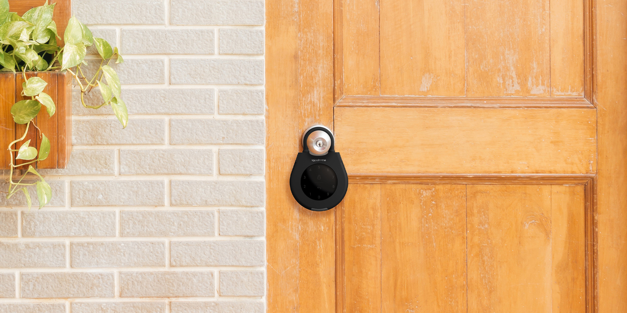 Igloohome smart keybox hanging from the door handle