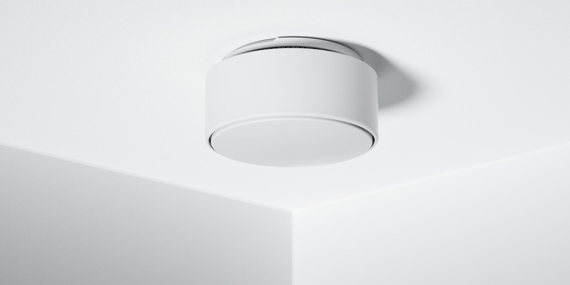 Minut home sensor installed on a white ceiling
