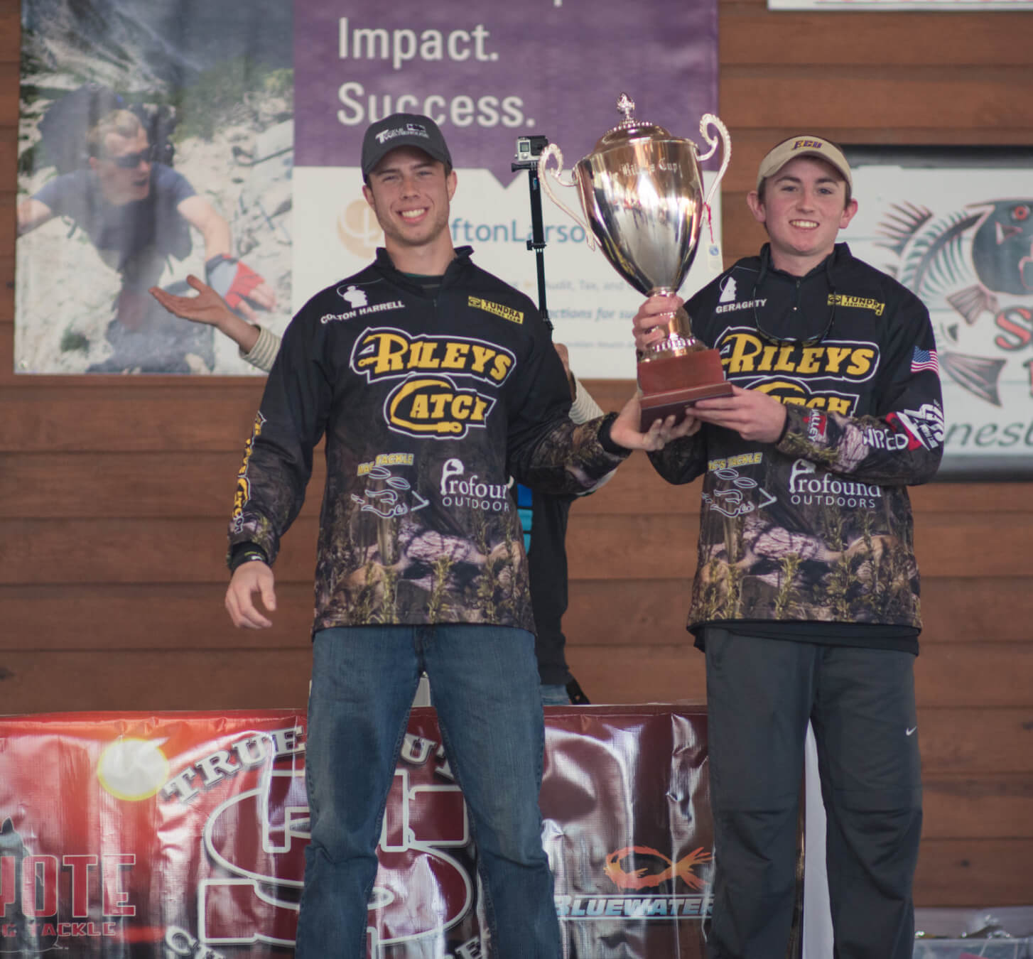 Riley's Catch team members holding up a trophy.