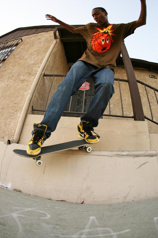 person skateboarding wearing hundreds merch