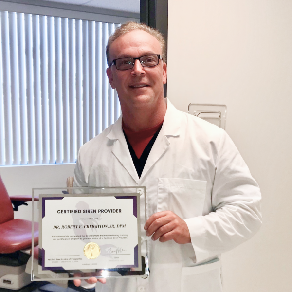 Dr. Creighton showing his certified Siren provider certificate.