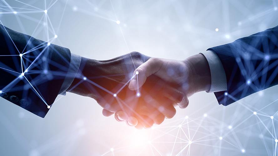Image of business men shaking hands