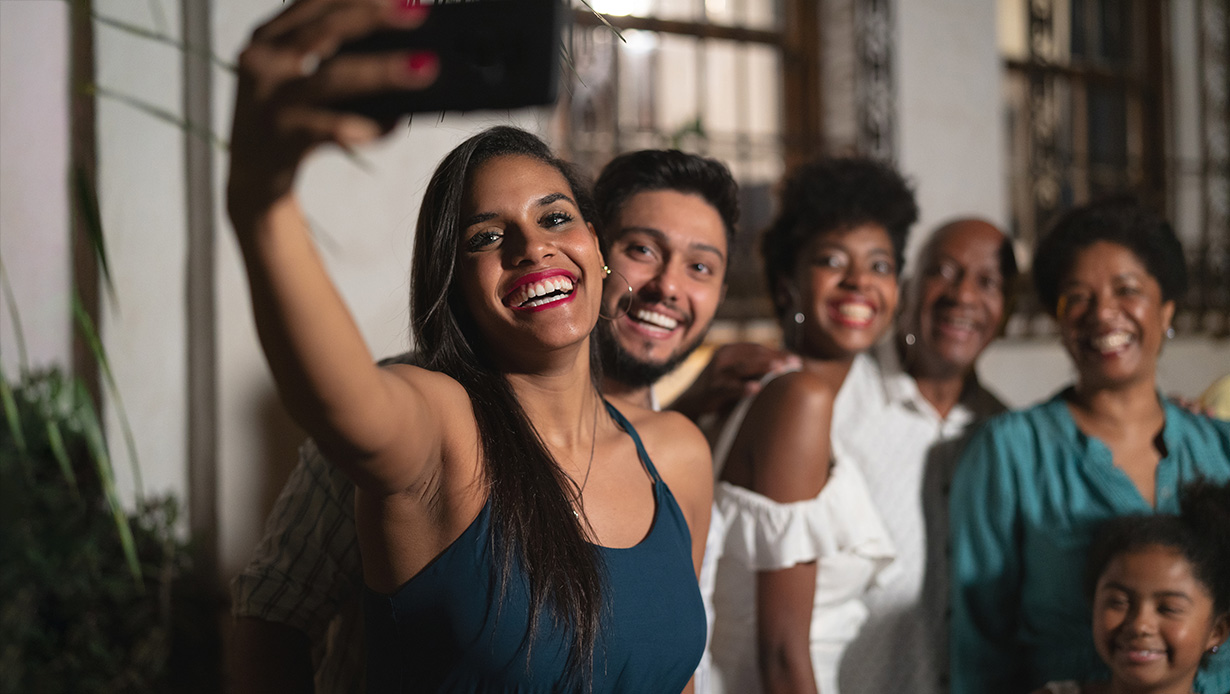 Image of of family taking a selfie