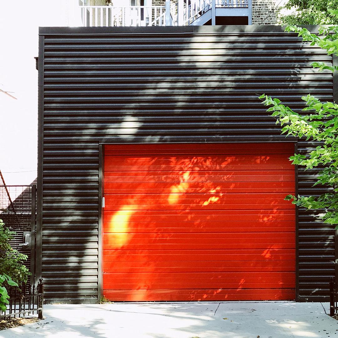 Orange garage door with security