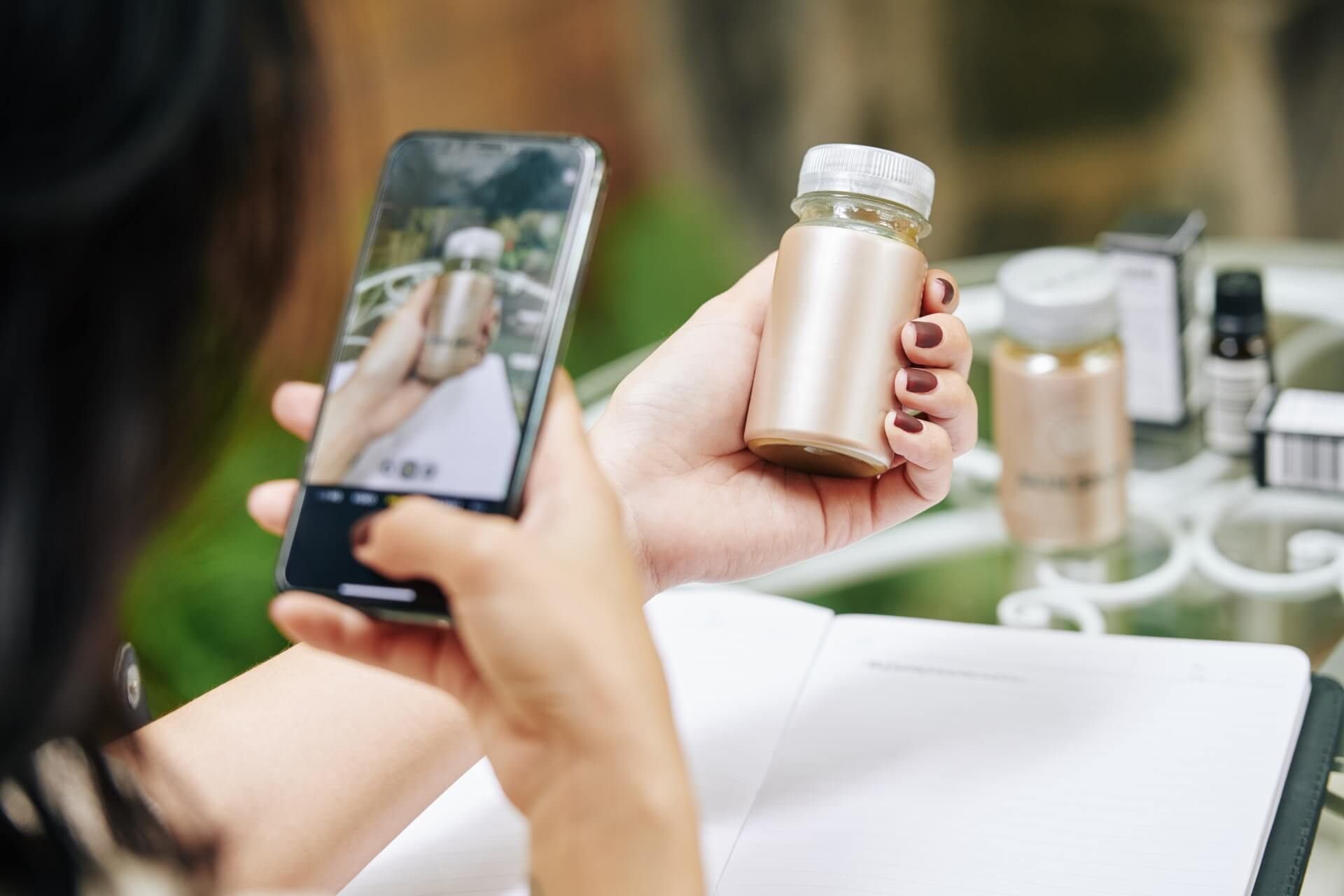 Woman takes a photo of some skin lotion
