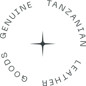 """A circular badge that says """"Genuine Tanzanian Leather Goods"""""""