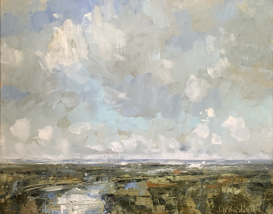 Clouds over the marsh with flowing water through middle against a large sky