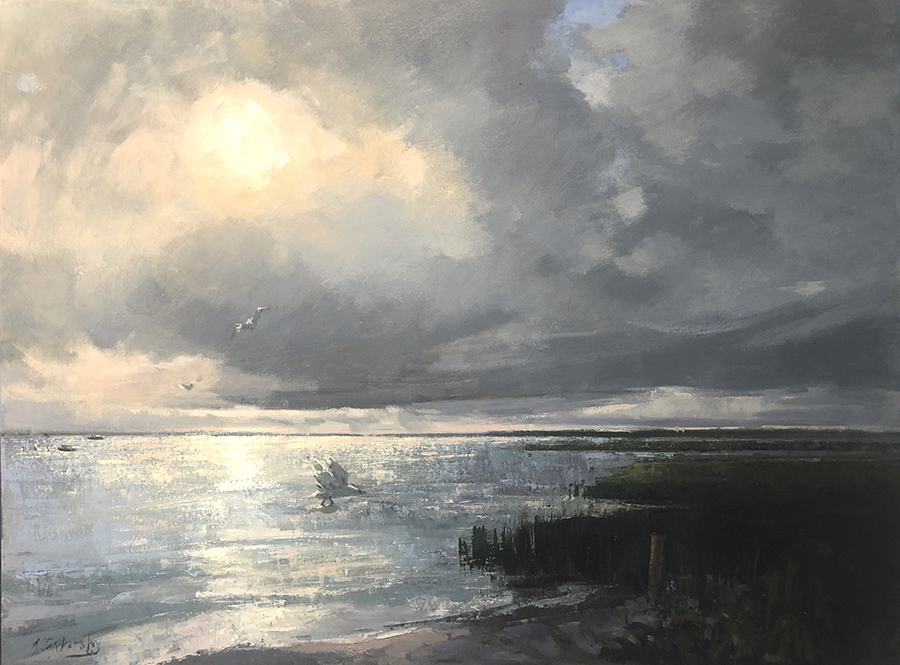Seascape showing twilight sky behnd clouds.