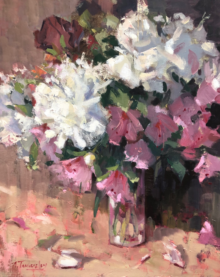 A flower arrangement of white peonies and pink azaleas in a glass vase.