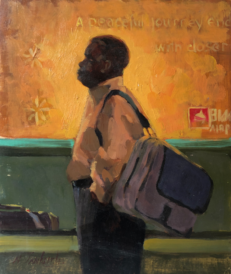 An African American man walking with a satchel over his shoulder in front of a richly painted walls in yellows and greens.