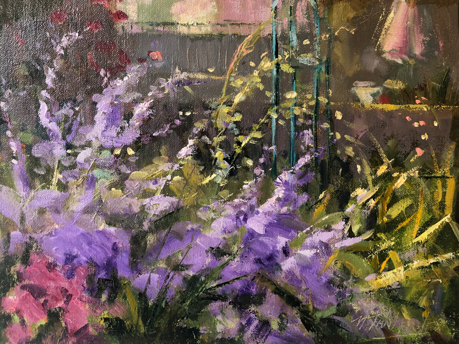 A close up of a lavender bush in a garden.