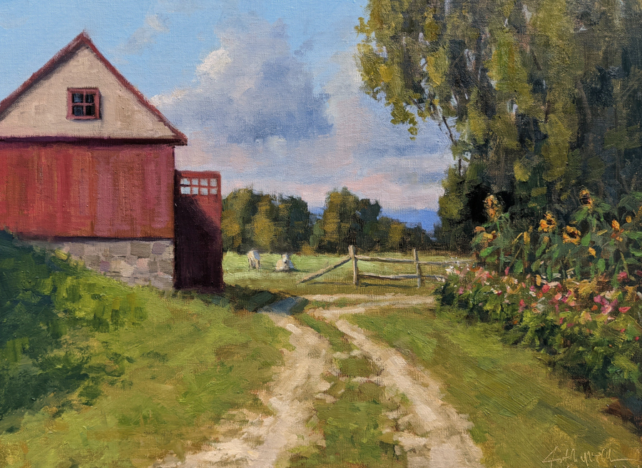 Winding road through farm with red barn on left and trees and garden on right.