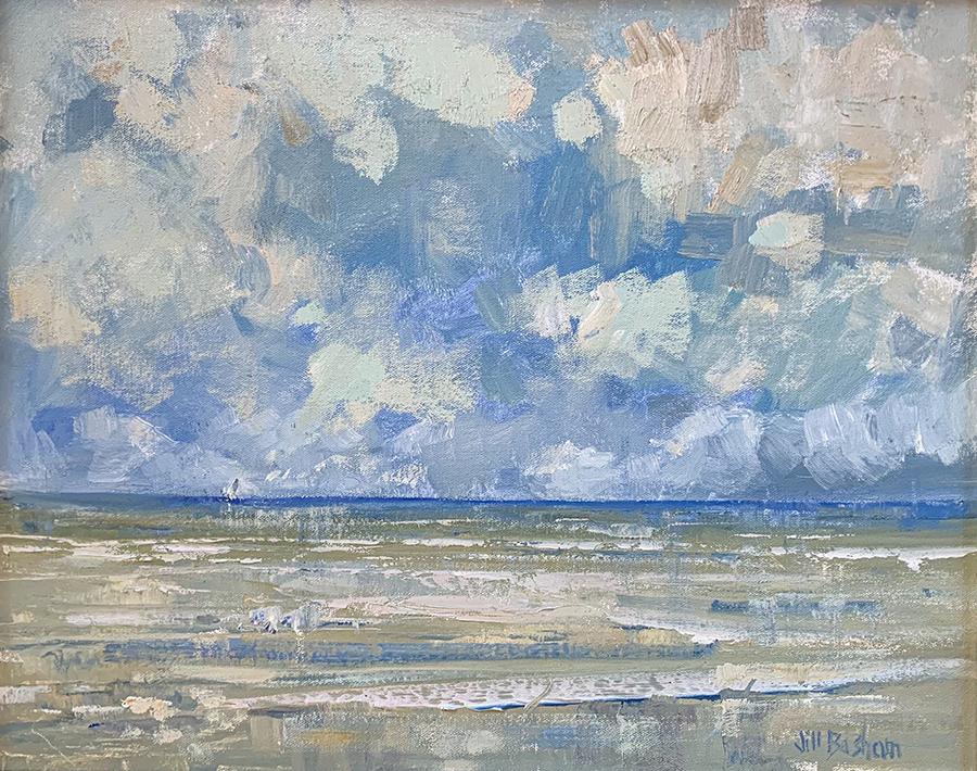 low-tide beach scene against a cloud sky